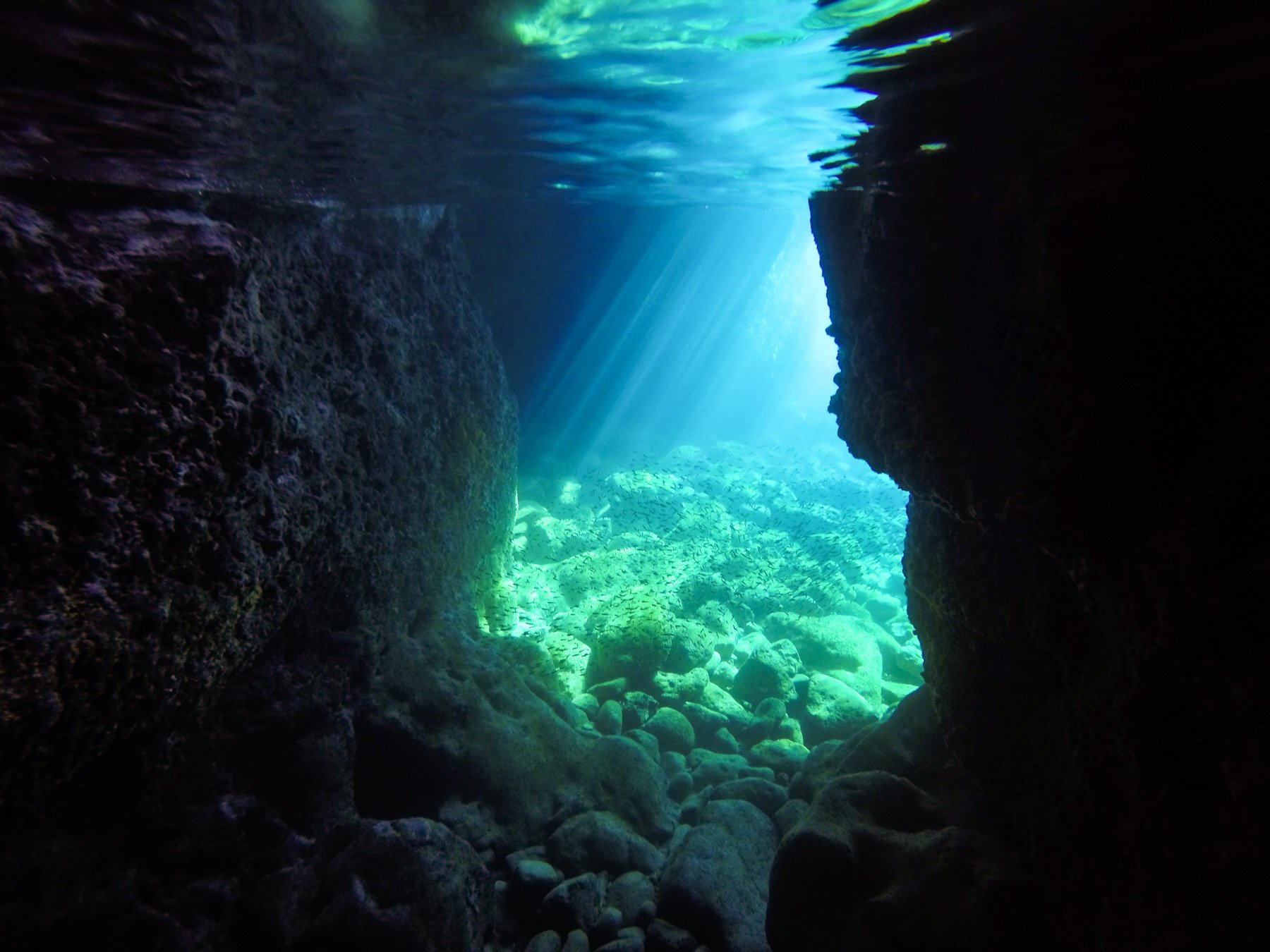 sunlight hitting the cave's water